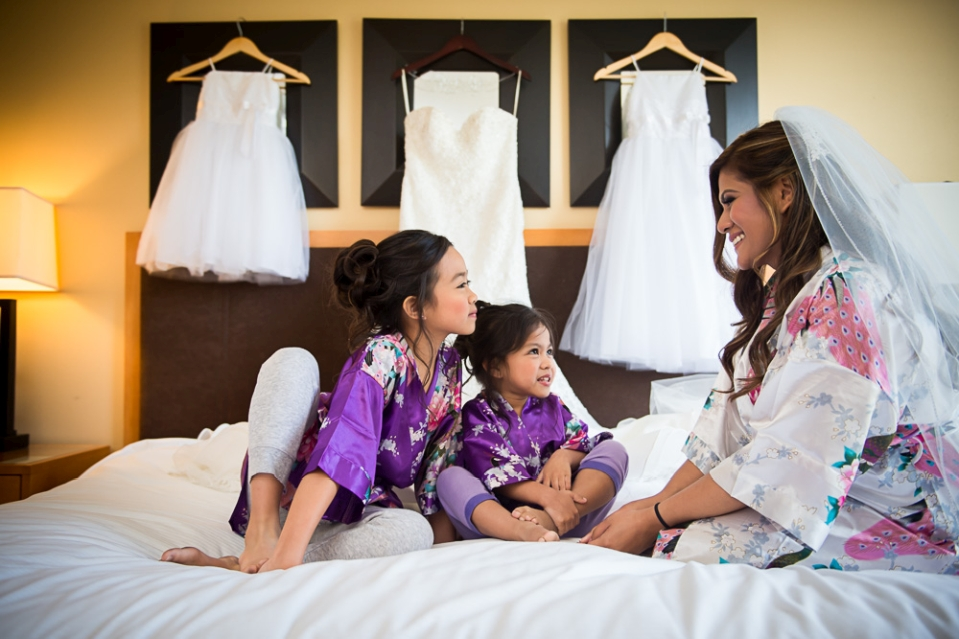 Bride and children on bed before the wedding.
