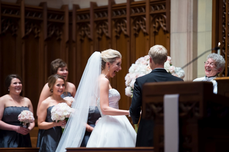 Bride reacts with great smile after being wed.