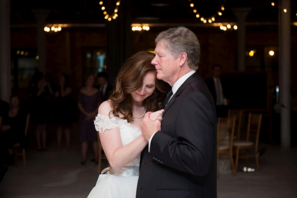Bride dancing with her dad during father-and-daughter dance at a wedding.