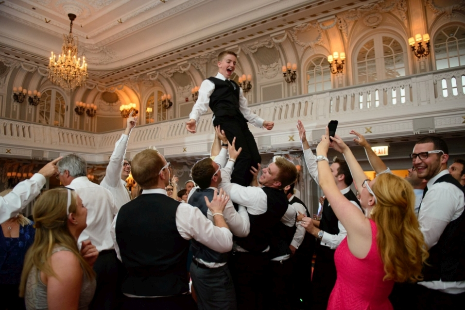 Guests having fun, lifted a boy up.