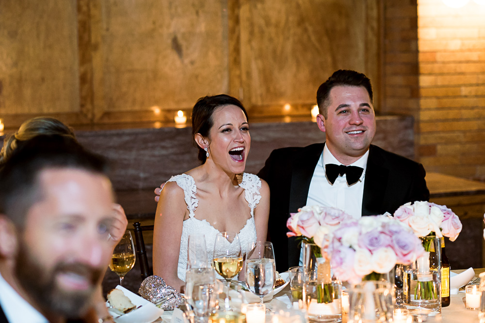 Bride reacts to a speech.