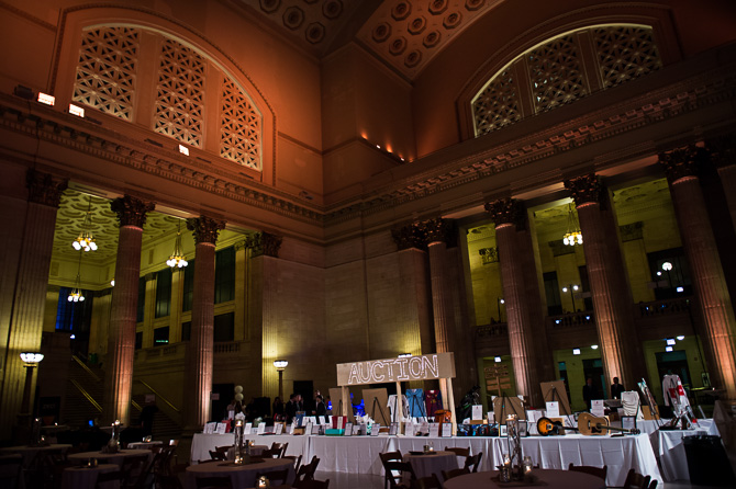 Overview of the event's auction tables in Chicago's Union Station's Great Hall.