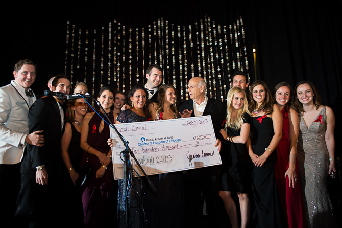 Donating a check to Lurie's Children hospital at Chicago during 2015 Snowball Fundraiser.