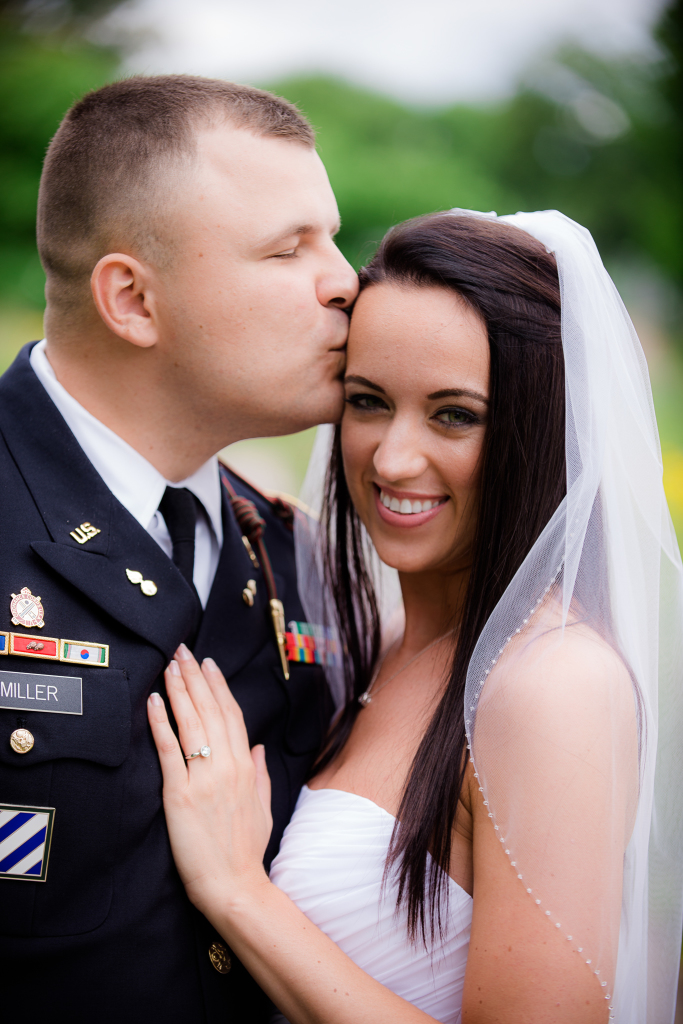 Kiss on bride's forehead.