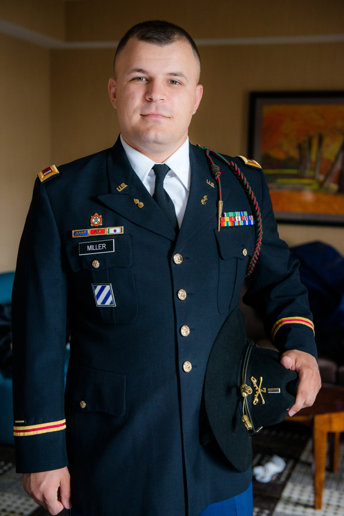 Portrait of a groom in a uniform.