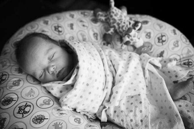 Black and white photo of adorable sleeping child.