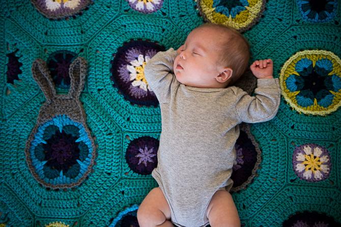 Little baby on a cute blanket.